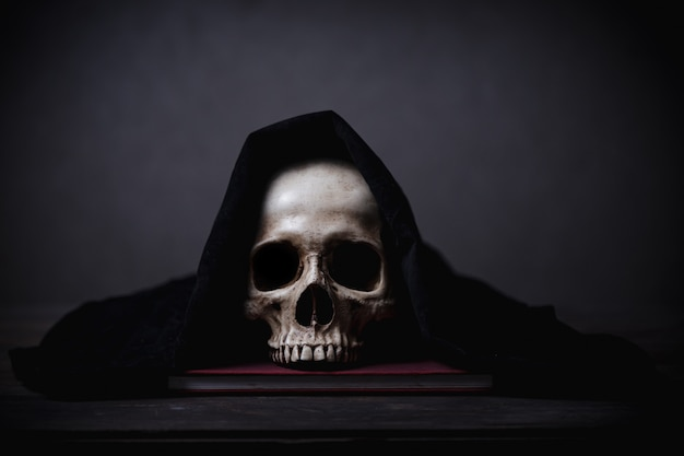 Covered human skull posed on a desk