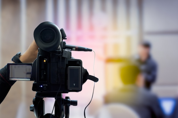 Covering event on stage with video camera