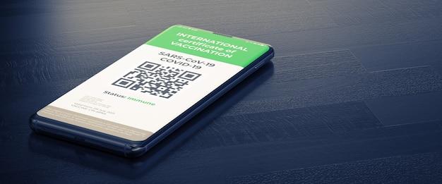 Covid-19: 스마트폰 화면의 디지털 그린 인증서. 백신을 접종한 디지털 건강 여권으로 어두운 표면에 누워 있는 스마트 폰.