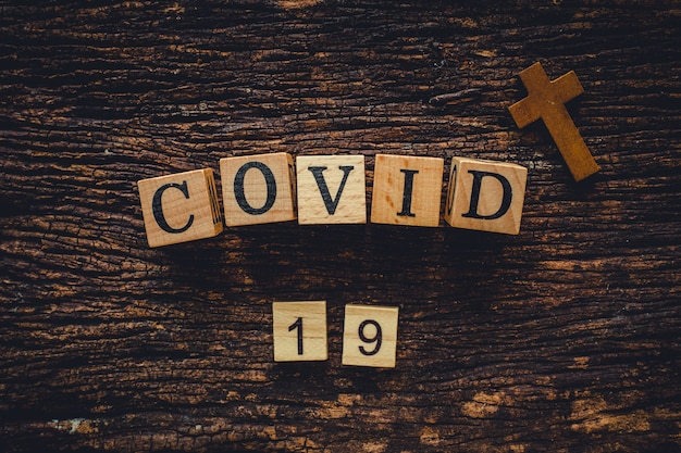 Covid-19 name of corona virus from wuhan text word on old wood vintage nature background.