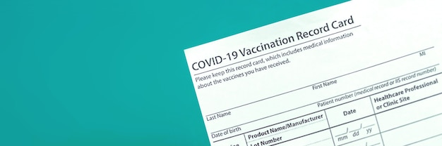 Covid-19 vaccination record card close up banner, copy space photo