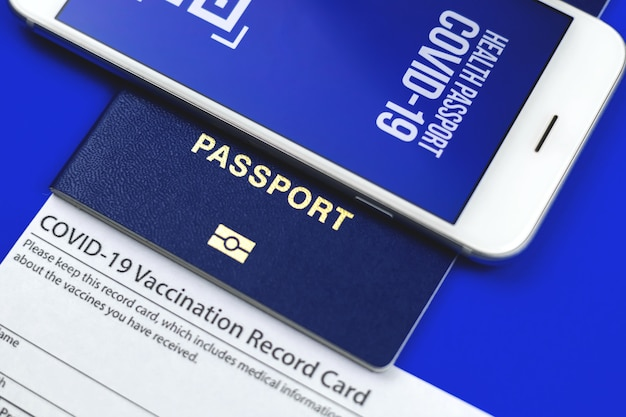 Covid-19 vaccination record card close up, immunity passport for travelers concept, close up photo