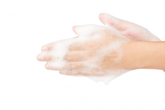 Мыльная пена для мытья рук, изолированные на белой стене убить коронавирусные бактерии covid-19