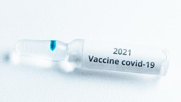 Covid vaccine concept in 2021. ampoule with medicine.