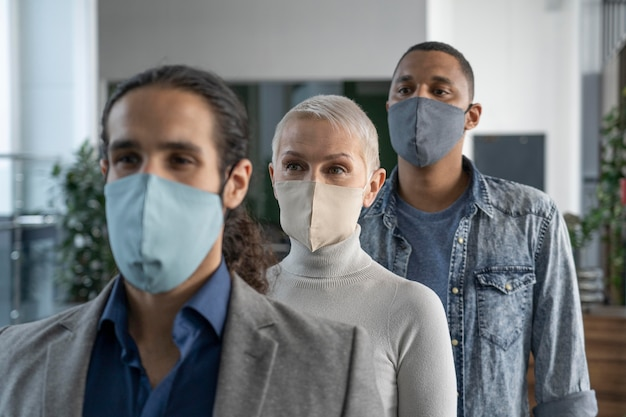 Coweorkers with medical masks working