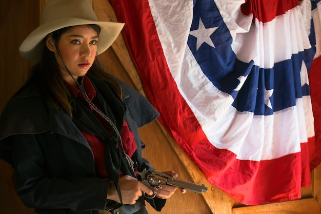 Cowgirl with a gun.life style of cowgirl.beautiful girl cowboy with a gun.