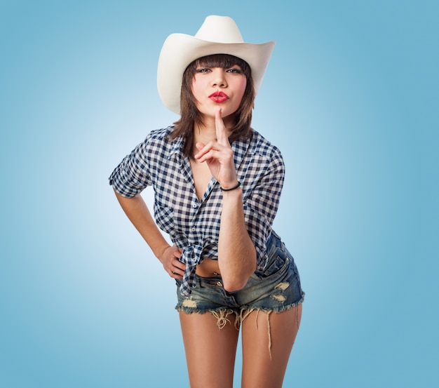 Cowgirl with an index up