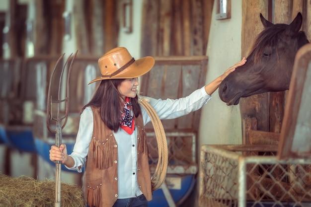Cowgirls working at a horse farm, sakonnakhon, thailand.