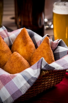 Coxinha, a brazilian snack, with a bar in the space.