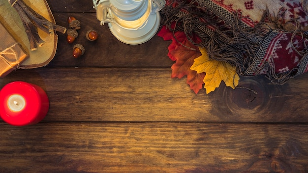 Cozy autumn composition with lantern and leaves