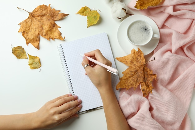 Cozy autumn concept background with coffee drink
