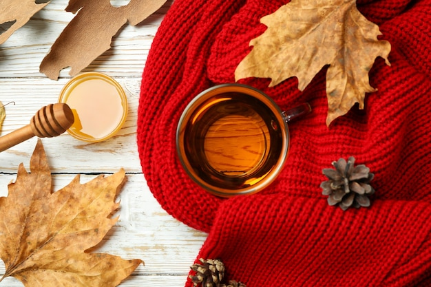 Cozy autumn concept background with tea drink