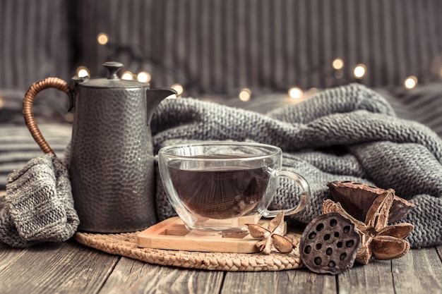 Cozy autumn still life with a cup of tea.