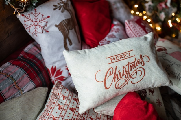 Cozy bed with christmas pillows decorated with christmas decor