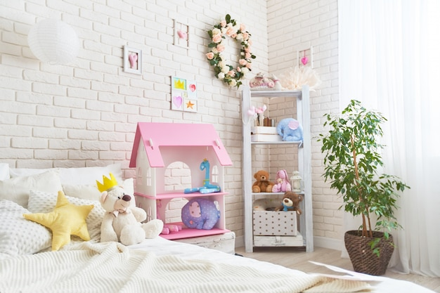 Cozy children room for little girl, with white wall with pictures