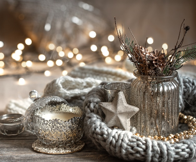 Cozy christmas composition with candles in a decorative candlestick. concept of home comfort and warmth.