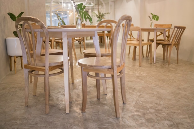 Cozy coffee shop with wooden furniture set