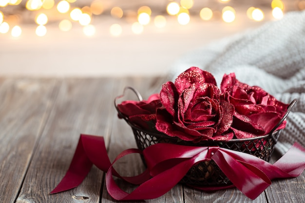 Cozy composition for valentine's day with decorative flowers in a basket copy space.