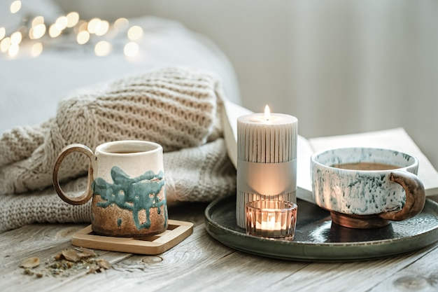 Cozy composition with ceramic cups and candles