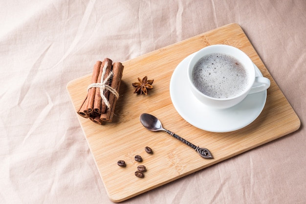 Cozy composition with a cup of coffee on a tray