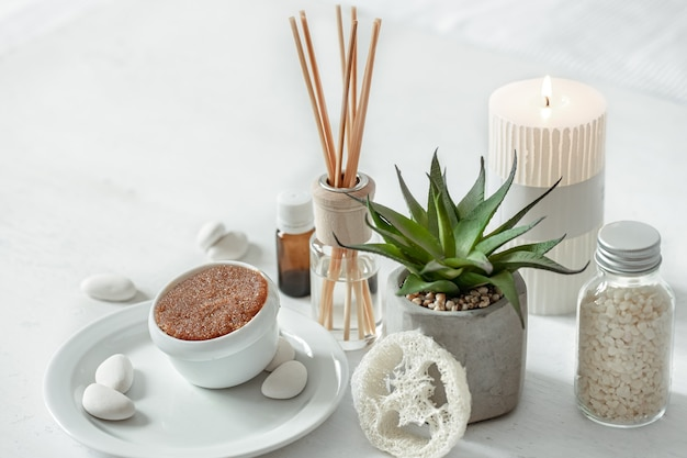 Cozy composition with incense sticks for indoor scent and health and beauty products.