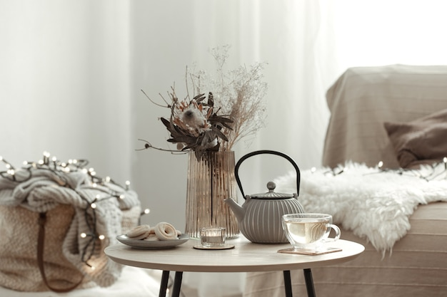 Cozy home composition with tea in a scandinavian style home interior.