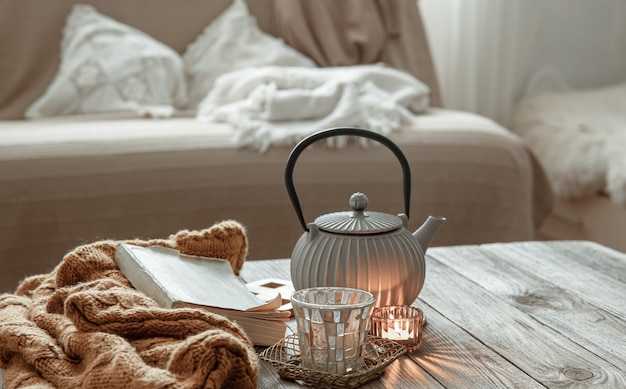 Cozy home composition with a teapot and decor details in the interior of the room