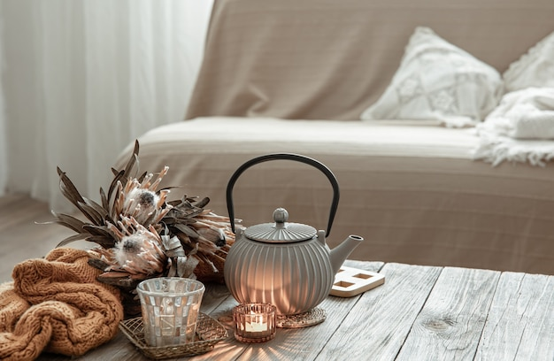 Cozy home composition with a teapot and decor details in the interior of the room.