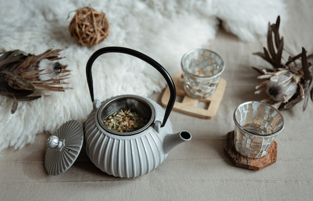 Cozy home composition with teapot and home decor details.
