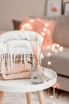 Cozy home decorations in the interior with knitting