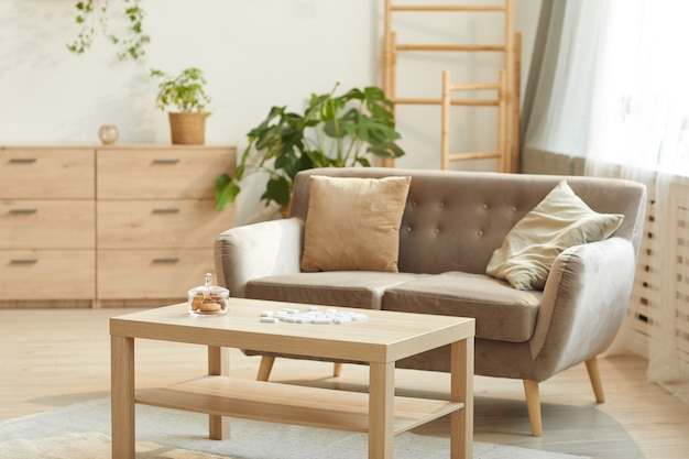 Cozy home interior featuring comfortable beige sofa and coffee table