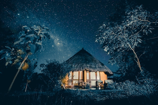 Cozy hut under a starry sky. fairy-tale background