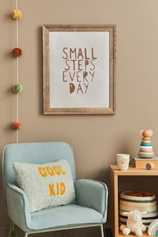 Cozy interior of child room with mint armchair, brown frame, toys, teddy bear, plush animal, decoration and hanging cotton colorful balls. beige wall. warm kid space.  template.