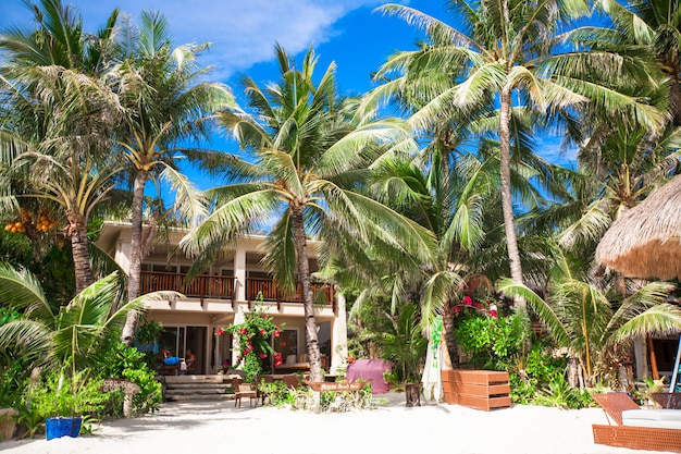 Cozy little hotel on a tropical exotic resort at white sandy beach