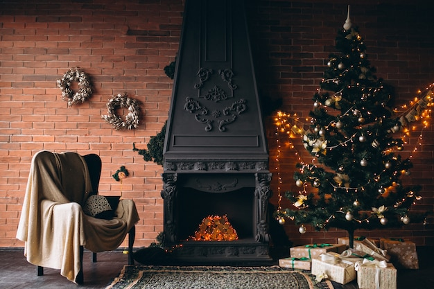 Cozy living room with fireplace and christmas tree