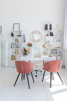 Cozy luxury modern interior design of a studio apartment in extra white colors with fashionable expensive furniture in a minimalist style.