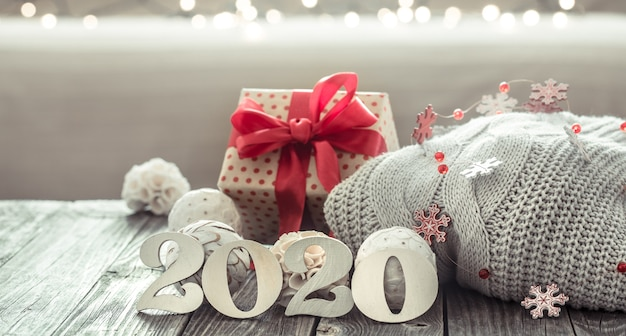 Cozy new year background new year 2020 on wooden background.