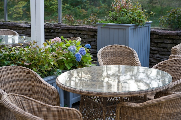 Cozy outdoor terrace at restaurant cafe or hotel in city garden park or forest with no people
