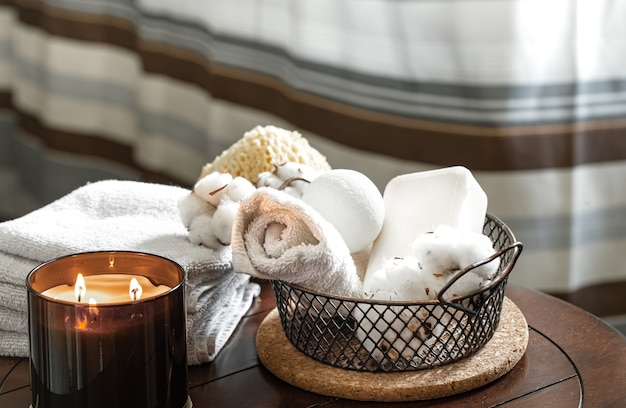 Cozy spa composition of aroma of candles and bath towels, soap. body care and hygiene concept.