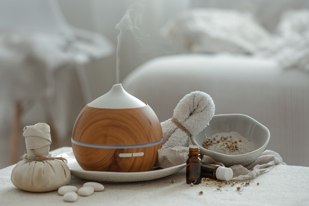 Cozy still life with a humidifier in the interior of the room on a blurred background.