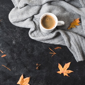Cozy sweater and coffee cup with copy space