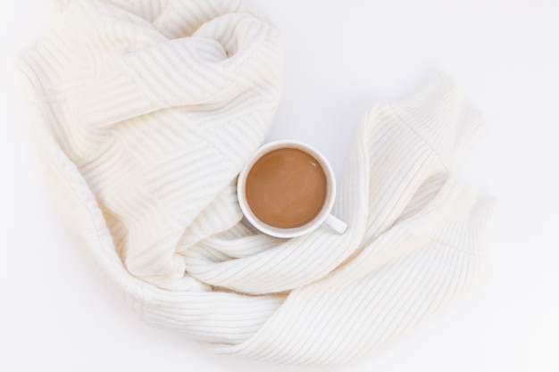 Cozy white warm sweater and coffee cup autumn mood
