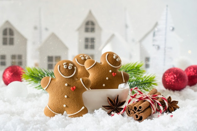 Cozy winter composition with a cup of hot chocolate and gingerbread