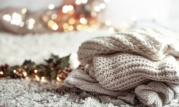 Cozy winter composition with knitted items on a blurred background