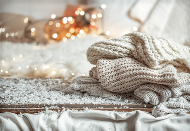 Cozy winter composition with knitted items  with bokeh.