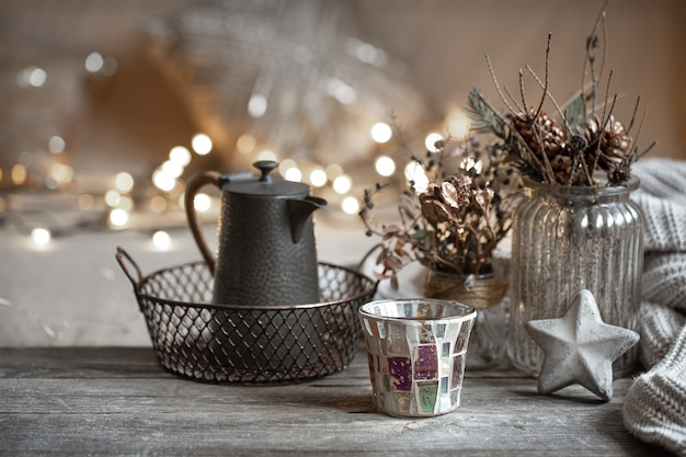 Cozy winter details of home decor with lights copy space.