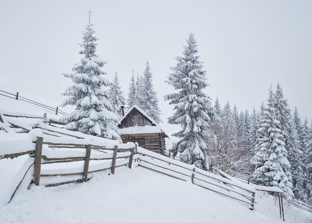 Cozy wooden hut high in the snowy mountains.