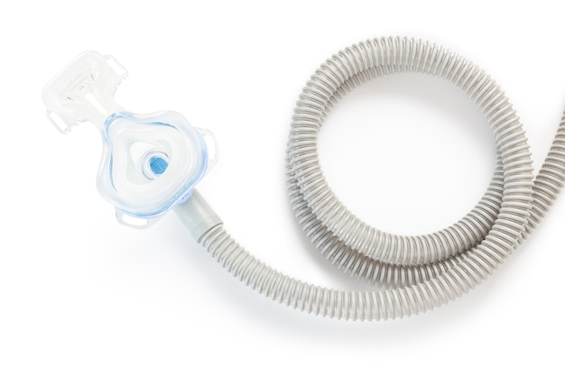 Cpap mask and hose on white background