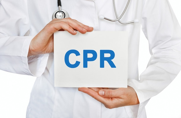 Cpr cardiopulmonary resuscitation card in hands of medical doctor