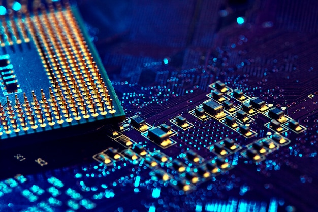 Cpu desktop with the contacts facing up lying on the motherboard of the pc.